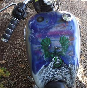 Wes's artwork on his wife's Sportster.