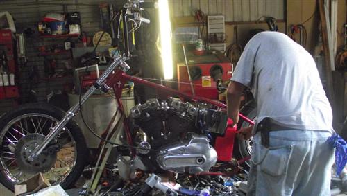 Wes working on a Sportster chopper.