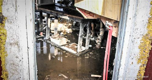 Flooded basement after asbestos abatement contractors broke the main water main