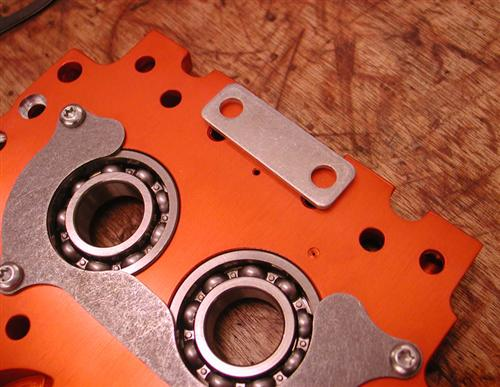 The S&S supplied plate to plug off the hydraulic chain tensioner oil feed hole.