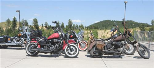 A few of the Biker Belles bikes waiting in their special parking space.
