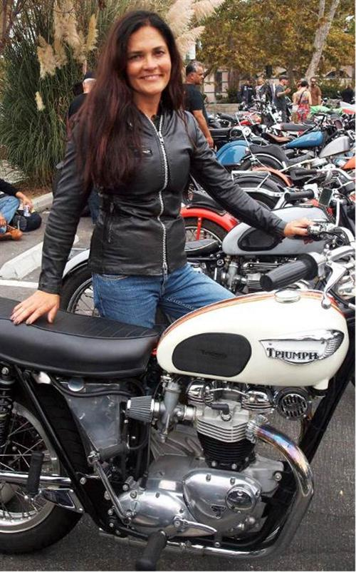 "Wendy Newton rode in on her '69 Triumph done up ""Bud Ekins"" style. Wendy also competes in AHRMA vintage racing."