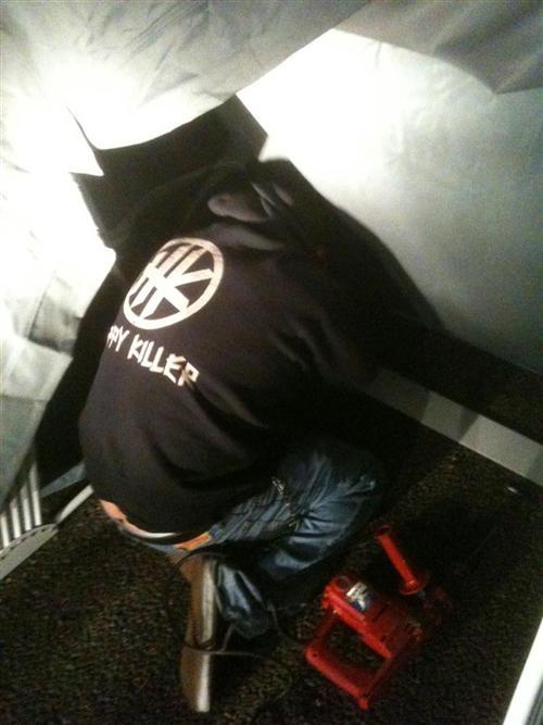 Jeremiah, the hippy killer installing the concrete screws.