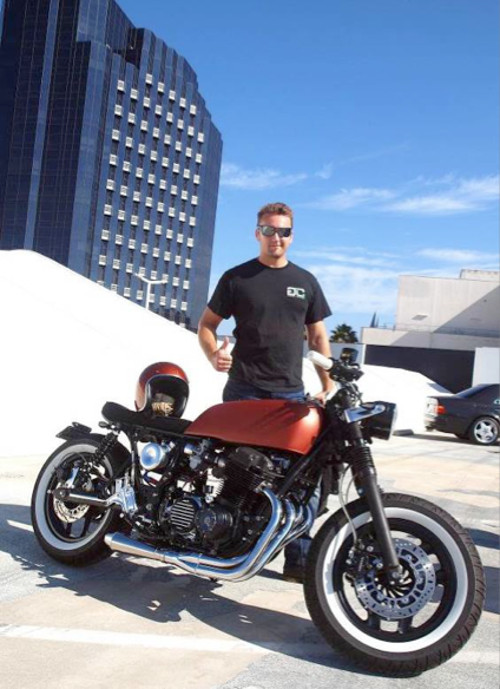 Adam Gaspic gives the thumbs up to his Gasser Customs Honda 750.