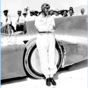 Sir Malcolm Campbell after setting his 301.1292 MPH record. Note all the salt on the car and around the wheels.