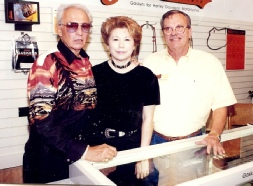 The late Evel Knievel, Diane Morrow, and Carl in their shop.