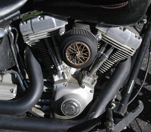 The Commander's Softail has a Bandit touch on his air cleaner.