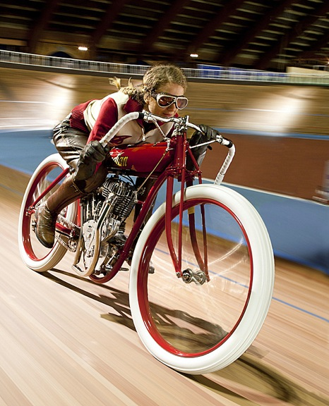 "At a Paris, France bicycle racing stadium (Le Velodrome du Bois de Vincenes), the Hendee Indian recreates past Board Track glories. In addition, back in the day, motorcycles were once used to ""draft"" racing bicycles."