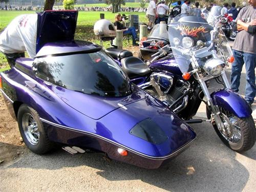 Modern sidecars get super swoopy. Note integral, covered headlight. Gotta love that Plumb Crazy Purple paint.