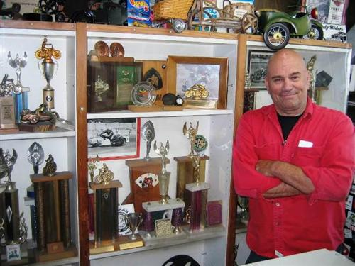 A few of Doug's racing and motorcycle industry awards shared space with his extensive collection of vintage motorcycle related toys.