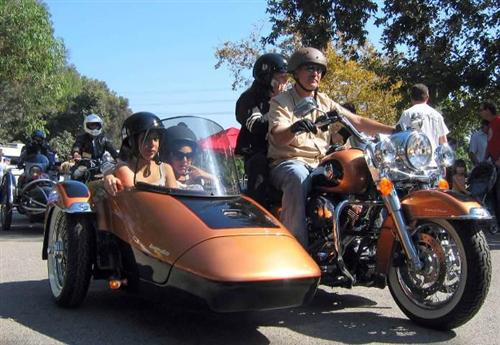 Three-wheeled Harley SUV with seating for family of four.
