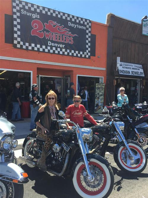 Donna and Arlin in front of 2Wheelers, Sturgis.