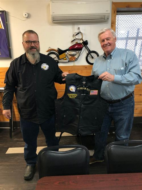 Congressman Collin Peterson of Minnesota receiving his MRF Legislative Champion vest from Gary Goracke, ABATE of Minnesota's Legislative Director.