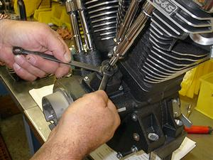 After rocker boxes and rocker arms are installed, pushrods are adjusted