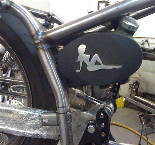 Nick's Mudflap Girl aluminum oil bag. We are thinking about running it on Frank's bike. He's going the Black and Chrome route. I'm the anti-chrome hot rod guy. Click on this image to reach Nick in NY city.