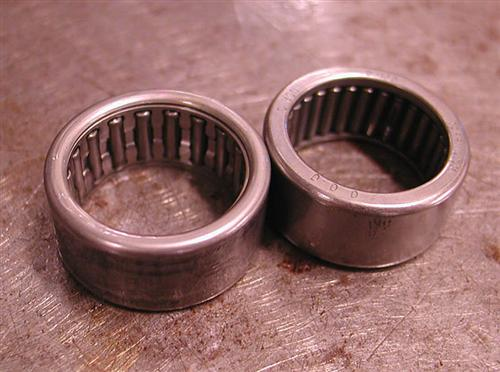 Here's the cheapy on the left next to the full compliment Torrington bearing.