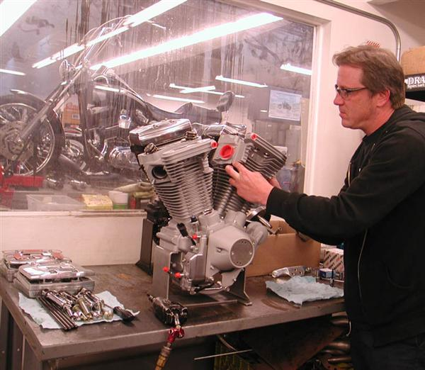 "Eric Bennett, tearing my brand new engine apart. ""I love working on new motors,"" Eric said. ""They're so clean."""