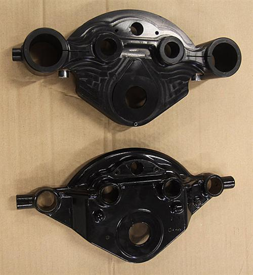 The CCE machined billet aluminium triple tree is shown at the top with the cast Harley-Davidson one at the bottom. There is a considerable weight saving with the aluminium unit.