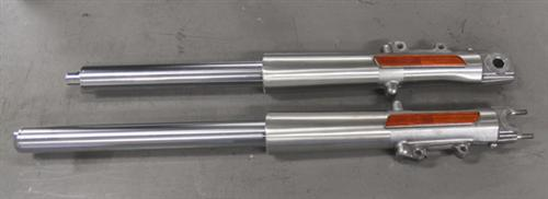The top lower fork leg still contains the old fork tube while the one on the bottom has had the CCE tube installed.